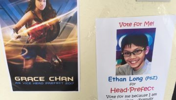 Photo 3- Canvassing Posters around the school